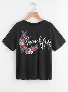 Tee-shirt brodé des fleurs avec la chute de l'épaule