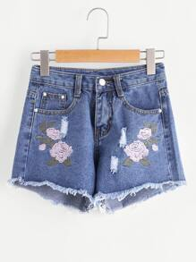 Shorts en denim roto de borde crudo bordado de flor