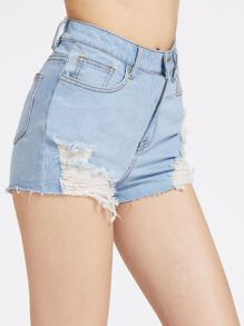 Pantaloncini di jeans lavaggio con fondo grezzo e strappi