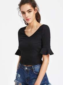 T-shirt skinny in maglia a coste con maniche a volant