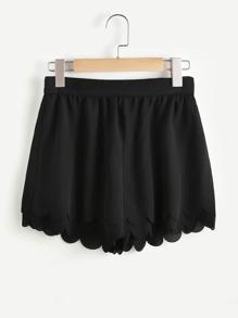 Pantaloni con fondo ampio ,con fondo smerlato