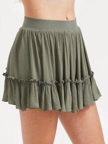 Falda-pantalón con volantes y espalda con cremallera