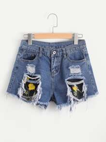 Shorts en denim de borde crudo aplique de malla de cuedrados