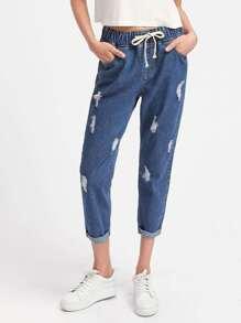 Pantaloni di jeans con laccetti in vita