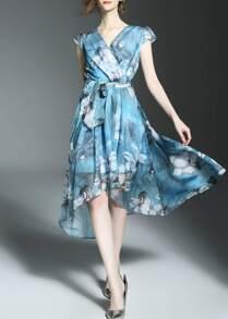 Vestito asimmetrico con scollo a v e stampa di fiore