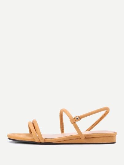 Sandalias planas con tiras