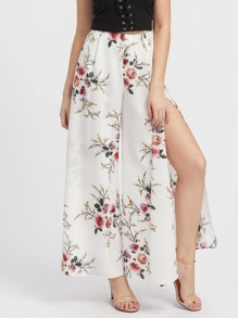 Модные брюки с вырезом и цветочным принтом