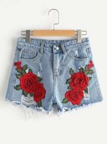 Pantaloncini di jeans strappati con appliques