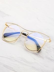 Gafas de sol con marco hueco y lentes redondas