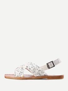 Sandales à fond plat croisé pierre embellie