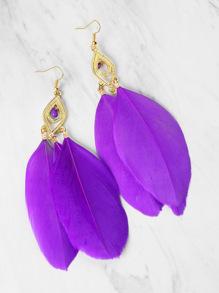Boucles d'oreilles décorées de plumes
