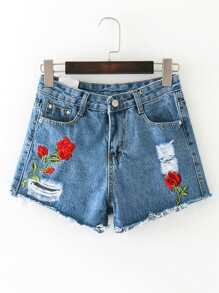 Shorts bordado roto en denim de borde crudo