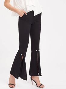 Pantalones con abertura en la parte delantera y vuelo