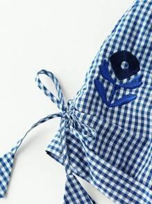 Модные клетчатые шорты с бантом и цветочной вышивкой фотографии