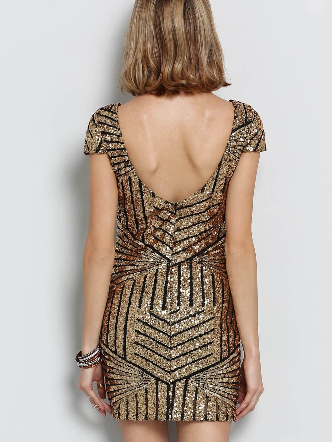 9b007026dff9 Vestito con paillettes schiena scoperta d oro
