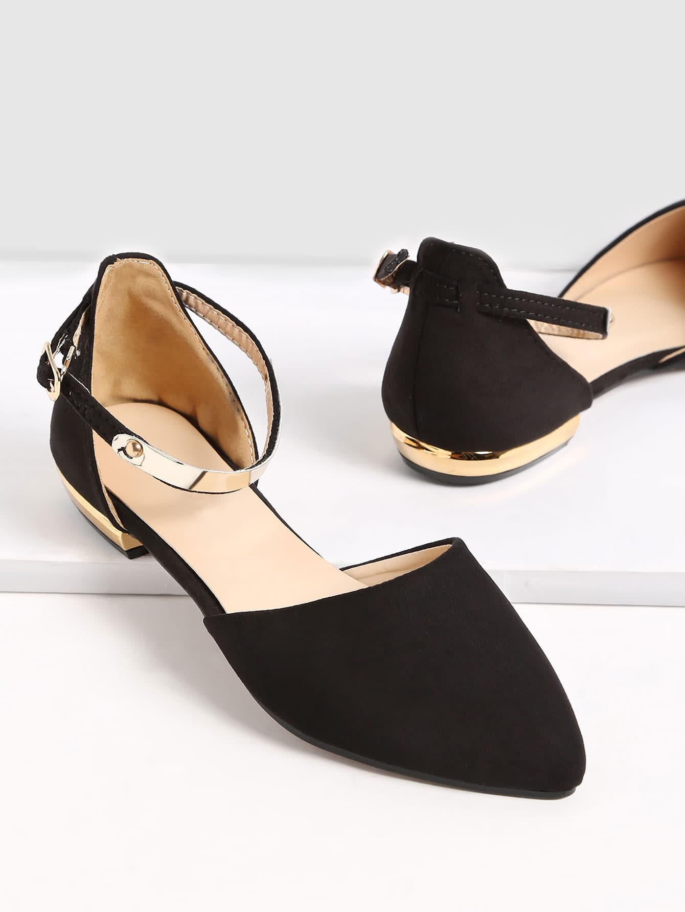 flat black point toe shoe with gold heel detail