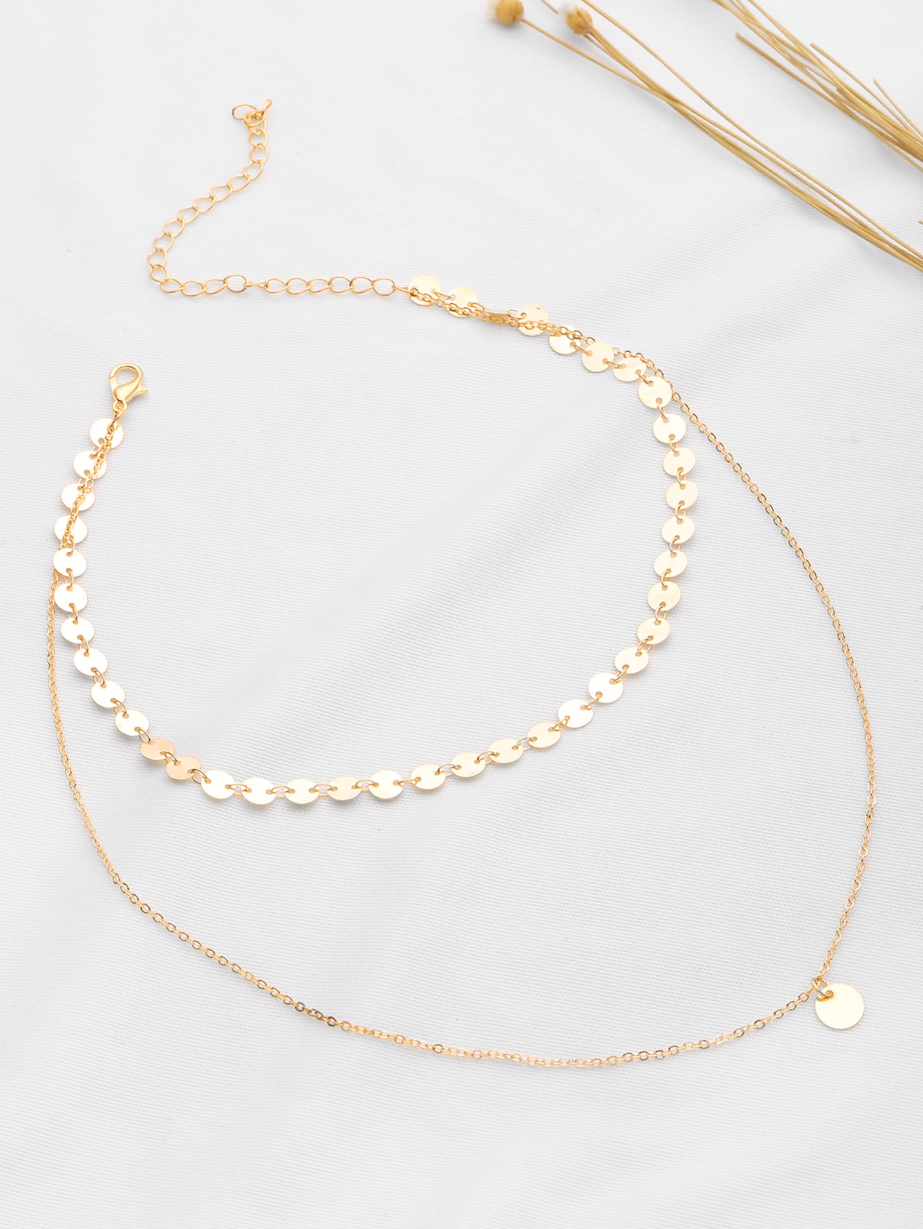 gold necklace with small circle details