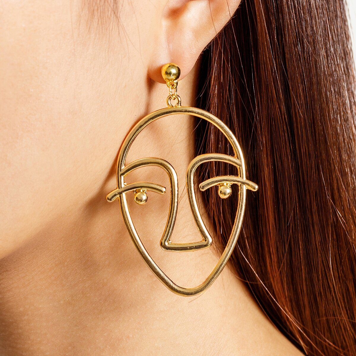 - Metal Face Shaped Drop Earrings