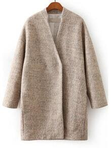 Бежевое шерстяное пальто свободного кроя